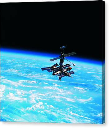 A Space Station Orbiting Above Earth Canvas Print by Stockbyte