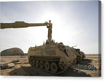 A Us Army Mechanic Uses A M113 Canvas Print by Terry Moore