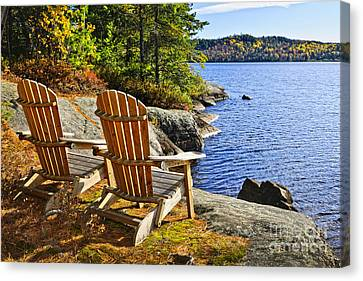 Chair Canvas Print - Adirondack Chairs At Lake Shore by Elena Elisseeva