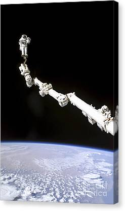 Astronaut Anchored To A Foot Restraint Canvas Print by Stocktrek Images
