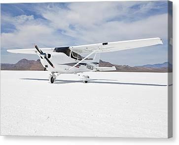 Cessna Aircraft On Bonneville Salt Flats Canvas Print by Paul Edmondson