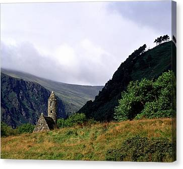 Chapel Of Saint Kevin At Glendalough Canvas Print by The Irish Image Collection