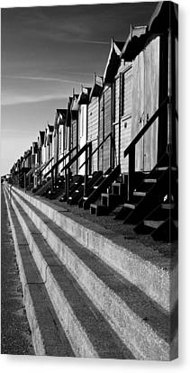 Frinton On Sea Beach Huts Canvas Print by Darren Burroughs