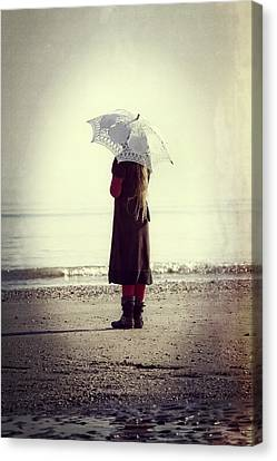 Girl On The Beach With Parasol Canvas Print by Joana Kruse