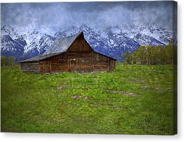Grand Teton Iconic Mormon Barn Spring Storm Clouds Canvas Print by John Stephens