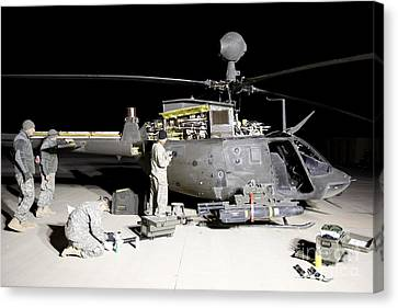 Maintenance Crew Works On Servicing Canvas Print by Terry Moore