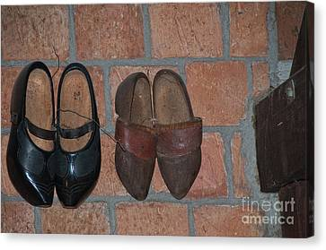 Old Wooden Shoes Canvas Print by Carol Ailles