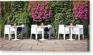 Empty Chairs Canvas Print - Outdoor Cafe by Tom Gowanlock