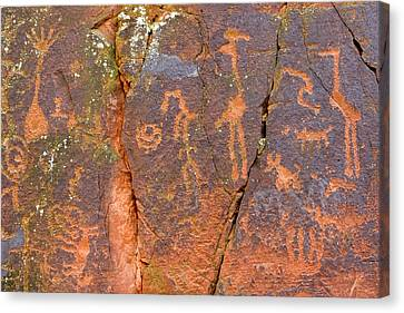 Petroglyphs Believed To Have Been Made Canvas Print by Charles Kogod
