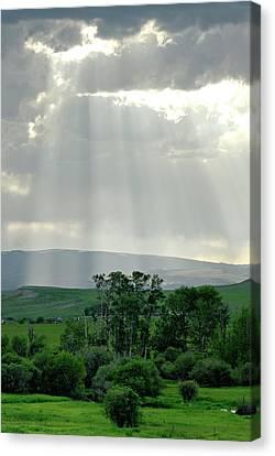 Rain Sun Rays Canvas Print by Roderick Bley