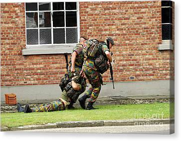 Soldiers Of The Belgian Army Helping Canvas Print by Luc De Jaeger