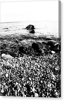 Stones At The Sea Canvas Print by Falko Follert