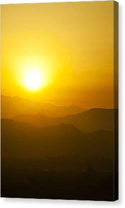 Sunset Behind Mountains Canvas Print by U Schade