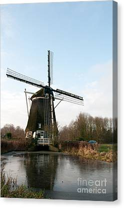 Windmill In Amsterdam Canvas Print by Carol Ailles