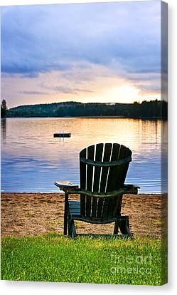 Wooden Chair At Sunset On Beach Canvas Print
