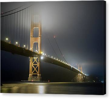 Canvas Print featuring the photograph Golden Gate Bridge At Night by Mike Irwin