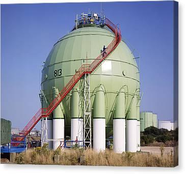 Oil Refinery Storage Tank Canvas Print by Paul Rapson