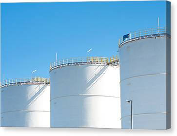 Canvas Print featuring the photograph Oil Tanks by Hans Engbers