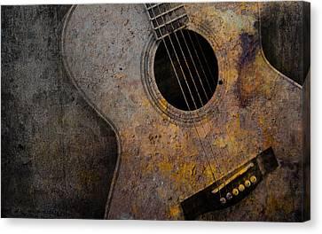 Old Guitar Canvas Print by Nattapon Wongwean