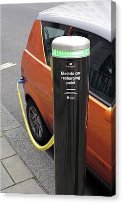 Recharging An Electric Car Canvas Print by Martin Bond