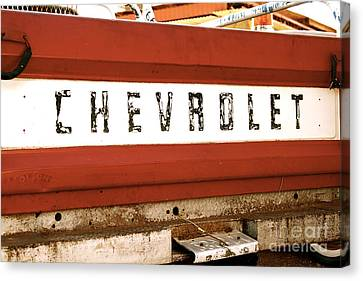 Rusted Antique Chevrolet Car Brand Ornament Canvas Print by ELITE IMAGE photography By Chad McDermott