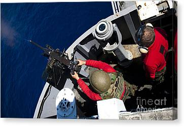 A Sailor Fires A .50-caliber Machine Canvas Print by Stocktrek Images