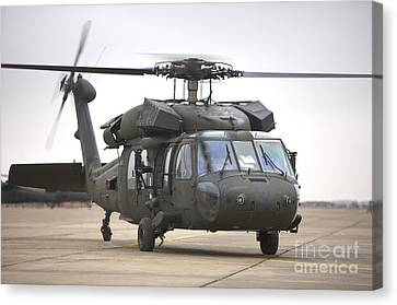 A Uh-60 Black Hawk Taxis Canvas Print by Terry Moore