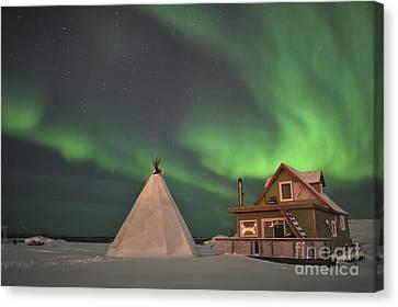 Northern Lights Above Village Canvas Print