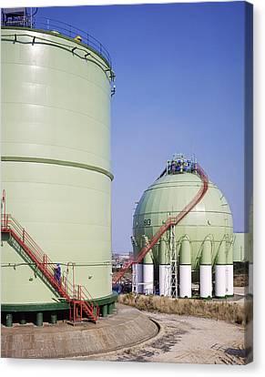 Oil Refinery Storage Tanks Canvas Print by Paul Rapson