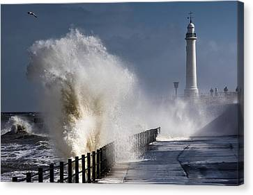 Waves Crashing By Lighthouse At Canvas Print by John Short