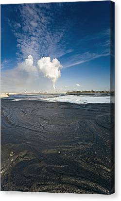 Oil Slick Canvas Print - Oil Industry Pollution by David Nunuk