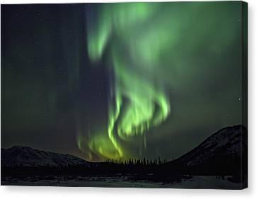 Aurora Borealis Or Northern Lights Canvas Print by Robert Postma
