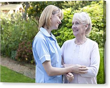 Nurse On A Home Visit Canvas Print by