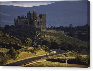 A Ancient Romanesque Castle Sits Atop Canvas Print by Cotton Coulson
