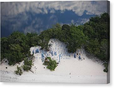 A Beach Cemetery Beside The Rio Negro Canvas Print by Bobby Haas