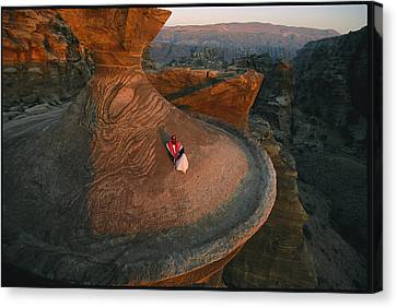 A Bedouin Surveys The View Canvas Print by Annie Griffiths