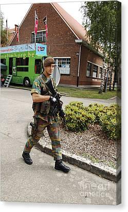A Belgian Soldier On Patrol Canvas Print by Luc De Jaeger