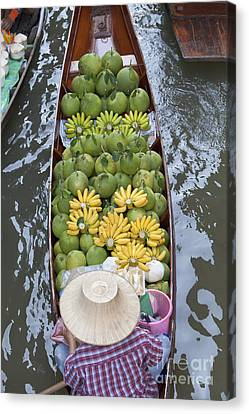 A Boat Laden With Fruit At The Damnoen Saduak Floating Market In Thailand Canvas Print by Roberto Morgenthaler