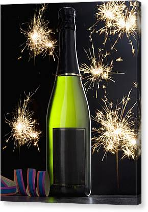 A Bottle Of Champagne And Sparklers Canvas Print