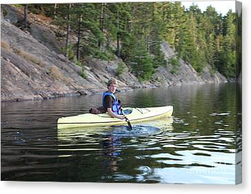 A Boy Kayaking Canvas Print by Ted Kinsman