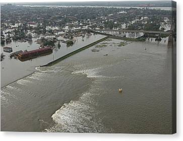A Breech In A New Orleans Levee Floods Canvas Print by Everett