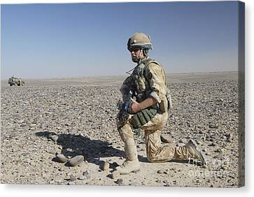 A British Army Soldier On A Foot Patrol Canvas Print by Andrew Chittock