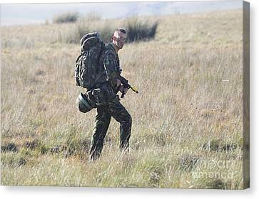 A British Army Soldier On Foot Patrol Canvas Print by Andrew Chittock