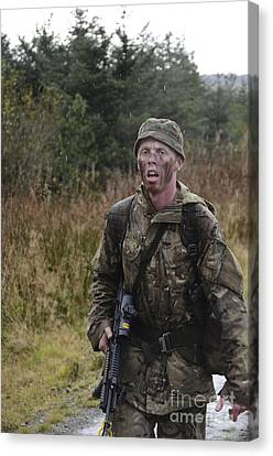 A British Soldier During Exercise Canvas Print by Andrew Chittock