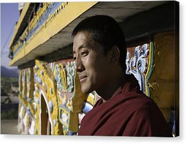 A Buddhist Monk Near The Edge Canvas Print by David Evans