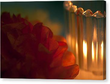 A Candle Glows Canvas Print