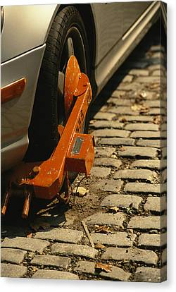 A Car With A Booted Tire Canvas Print by Richard Nowitz