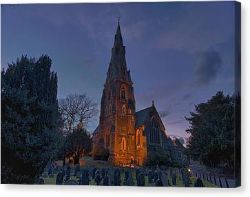 A Cemetery And Church Building Canvas Print by John Short