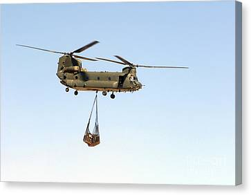 A Ch-47 Chinook Of The Royal Air Force Canvas Print by Andrew Chittock