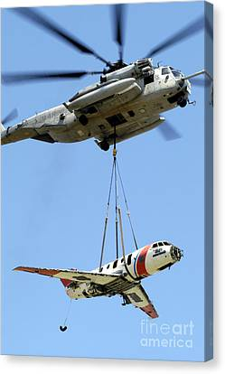 A Ch-53 Sea Stallion Lifts A Hu-25 Canvas Print by Stocktrek Images